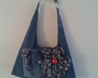 Handmade denim shoulder bag with flower