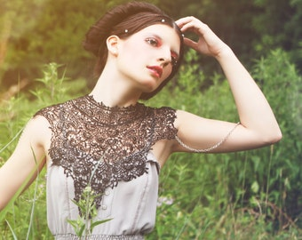 Steampunk lace black bib detachable collar necklace with silver chain epaulettes Body Tattoo featured on VOGUE.IT.