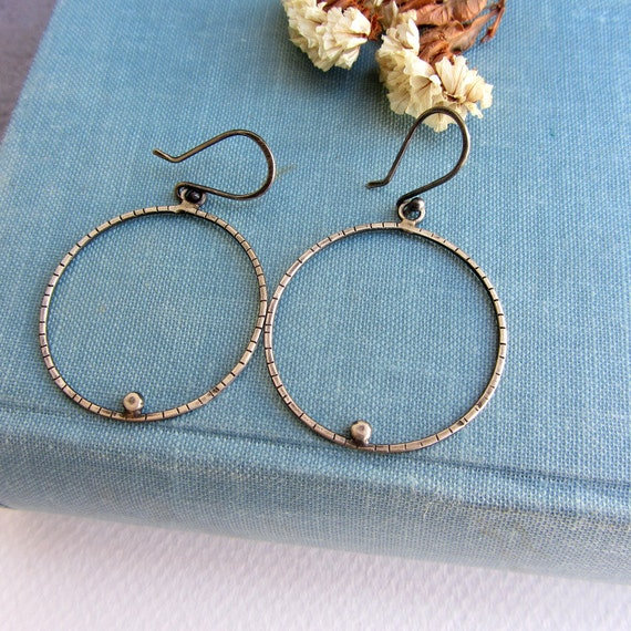 Silver hoop earrings, simple minimalist jewelry.