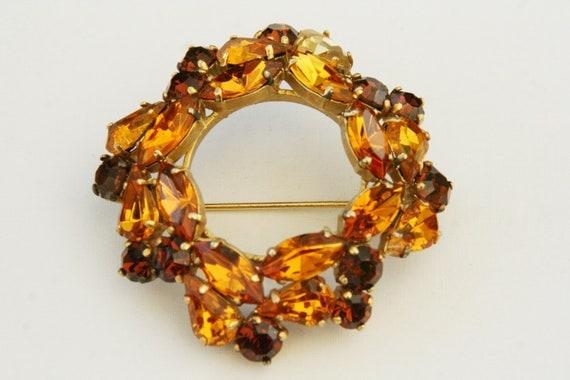 Vintage circle pin 1960s with orange and dark orange rhinestones, Italian vintage brooch, from Turin