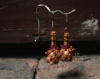 Earrings: Orange, olive, purple and cream, beadwoven
