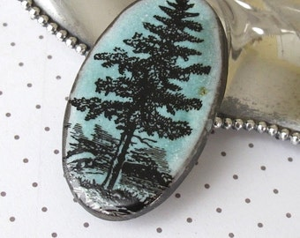 Pine Tree Brooch. Jade Green Glaze on Black Porcelain Oval. Sea Foam. Aqua Green. Cyan. Woodland. North Woods. Spruce. Fir. Nature. Rustic