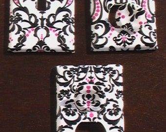 Damask Set Pink and Black on White Light Switch Toggle Cover Plate and 2 Outlets Set includes child safety plugs
