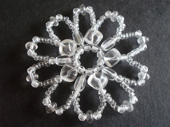 FOUR Christmas ornaments or decorations - stars or flowers - made of Czech glass beads, transparent glass, winter holiday