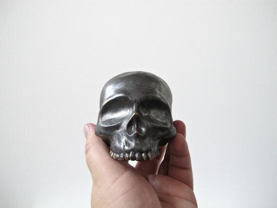 Human Skull ceramic halloween decoration in a stunning black metallic glaze for display