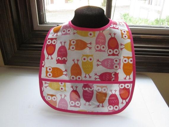 WATERPROOF WIPEABLE Baby to Toddler Wipeable Plastic Coated Bib Urban Zoologie Owls Orange and Pink