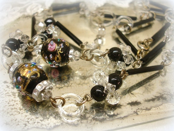 vintage czech glass necklace . jet black with wedding cake beads and crystal clear glass rings