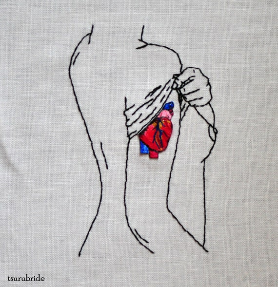 She Wears Her Heart on Her Sleeve Embroidered Wall Hanging