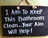 I aim to keep this bathroom clean your aim will help sign wood