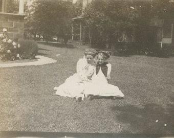 vintage photo 2 teen girls hug on lawn big hair twins maybe