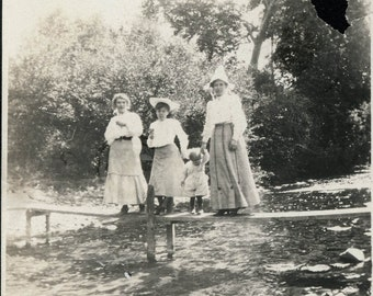 Vintage photo mother and children on footbridge over water 1909