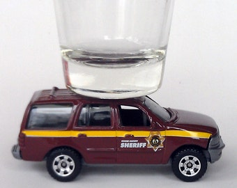 the ORIGINAL Hot Shots Shot Glass, Ford Expedition Sheriff, Matchbox