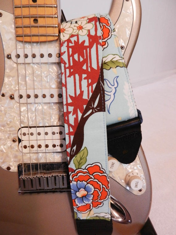 Asian inspired bright blue and red stars guitar strap