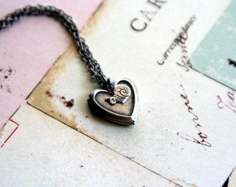 snail. heart locket necklace. silver ox