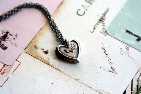 snail. heart locket necklace. silver ox