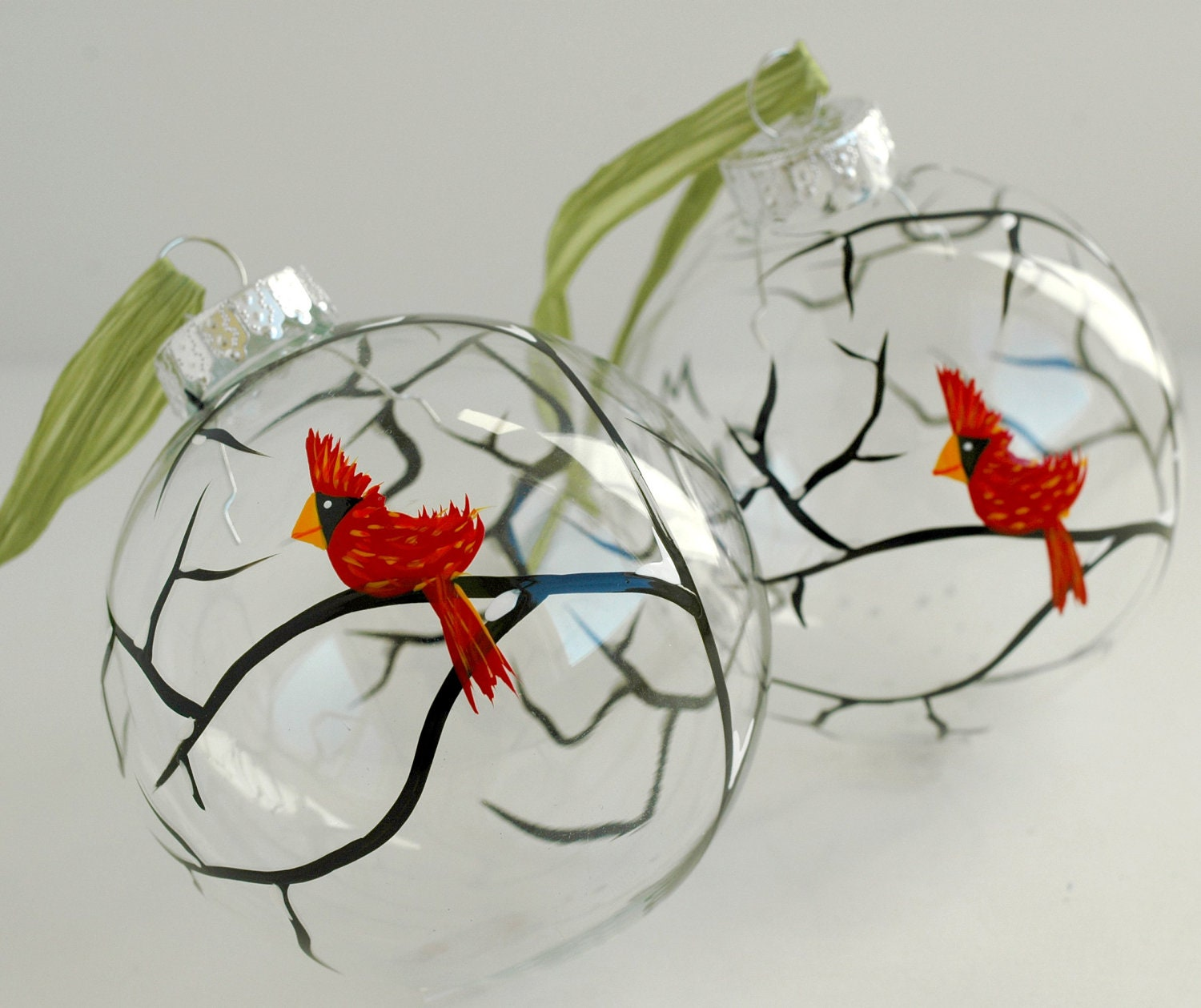 Red cardinals glass ornaments 2 large hand painted for Glass christmas decorations