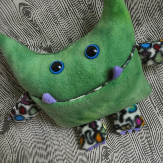 Wibbly Woo - a stuffed plush pocket monster in a mottled green