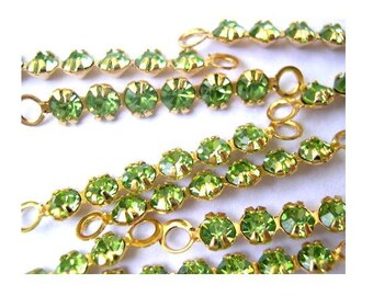 6 Vintage Swarovski crystal connector beads, 6 light green rhinestones in metal gold color setting- RARE