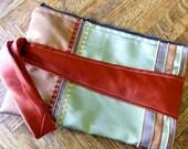 Zipper Clutch Wristlet purse in mocha and burnt sienna brocade upholstery w/ deep orange necktie