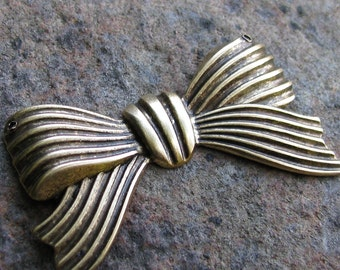 Large Bow Metal Stamping Antiqued Gold Jewelry Finding 912  - 4 pieces