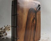 Address book from walnut wood and recycled paper.