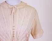 Vintage 1950s blouse with rhinestone buttons