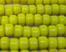60 Opaque Yellow Glass Crow Roller or Pony Beads 9x7mm