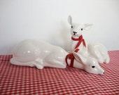2 vintage white pottery deer figurines