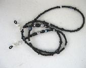 Eye glass chain made in black.