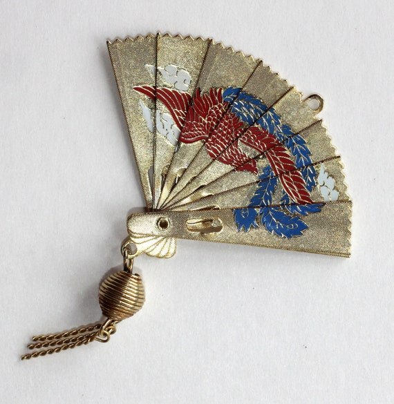 Folding fan pendant with asian design and tassel