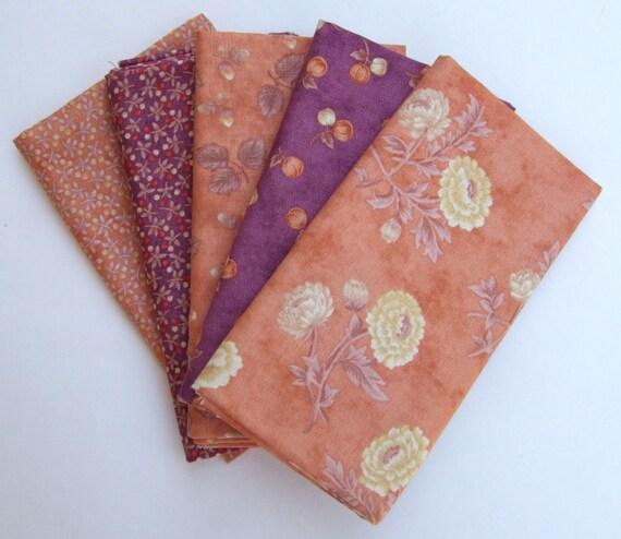 Set of five fat quarters in orange and purple prints
