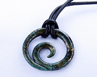 Constant Motion Bronze Pendant in ocean floor