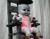 The orphanage of misfit babes.  Life size electric chair with lightning effect lights.