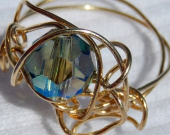MELITA. AB yellow green blue crystal glass and solid brass wire wrapped ring. size 9