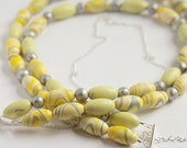 Reserved Order. 10 oval clay beads in yellow swirl.