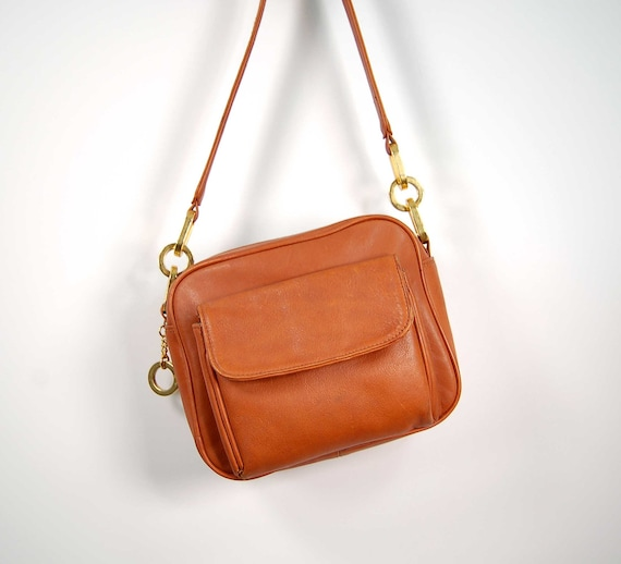 cross body leather purse  / sweet pumpkin leather and metal loops / Vintage 1970s designer's purse