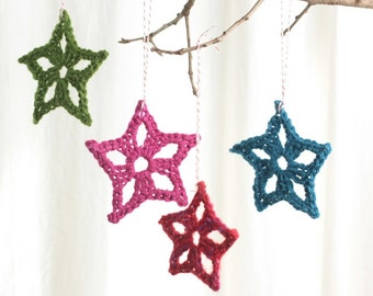 Star Christmas ornament, package tie ons, hand crocheted star,  set of four assorted colors
