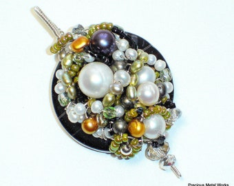 Caprice, handcrafted, wire wrapped, black agate disc pendant of sterling silver wire, pearls, seed beads and crystals