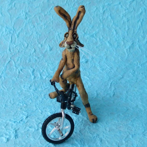 Ceramic Rabbit on Toy Bicycle Whimsical Sculpture