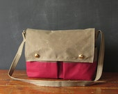 on sale. the SCOUT messenger bag. brown and red waxed canvas.