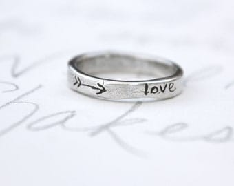 skinny silver wedding ring with arrow . recycled silver wedding band . love heart ring . silver stacking band by peacesofindigo