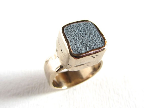 Rustic bronze ring with pale blue concrete