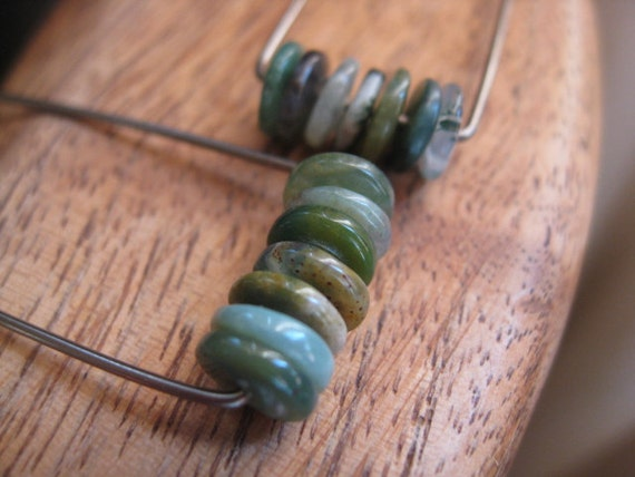 Custom earrings niobium hoop earrings in charcoal niobium. green stone earrings. hypoallergenic earrings. splurge.