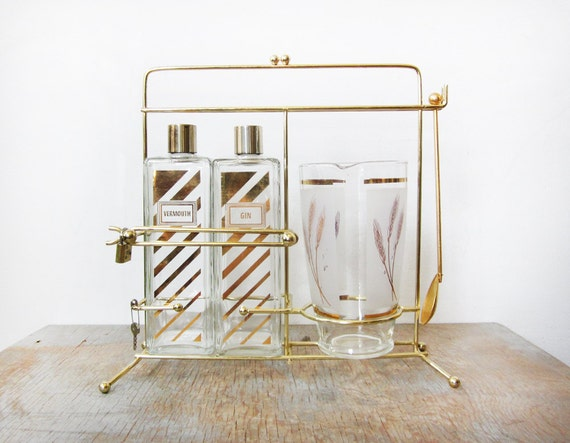 mid century gold decanter set / 1960s gold glass liquor decanter set with carrier / martini set