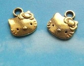 10 Hello Kitty charms, gold tone, 13mm