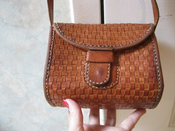 Small boxy woven leather shoulder bag or crossbody bag