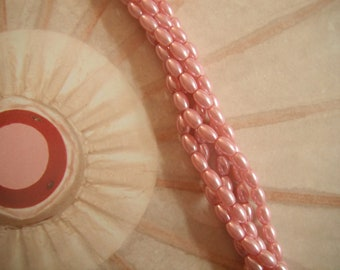 Rosy Pink Glass Rice Pearl Beads 6x4mm. (2) 15.5 Inch Strands.