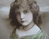 Antique girl photo postcard, pretty in green, 1910s