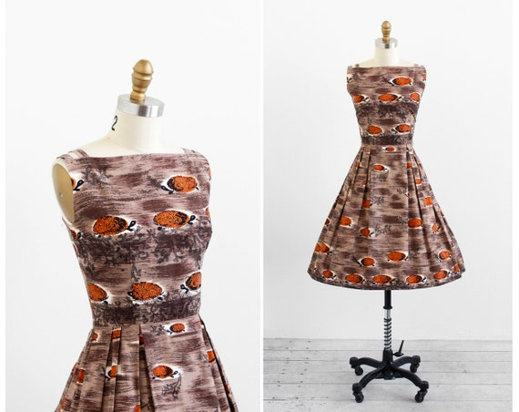 vintage 1950s dress / 50s dress / Brown Tiki Turtle Print Novelty Print Cotton Dress