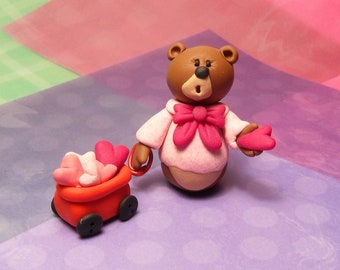 Handmade Polymer Clay Bear wearing bowtie with red wagon full of hearts 2 piece figurine set
